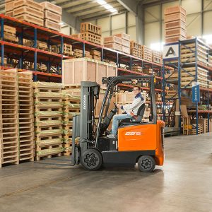 a man loading pallets with doosan forklift