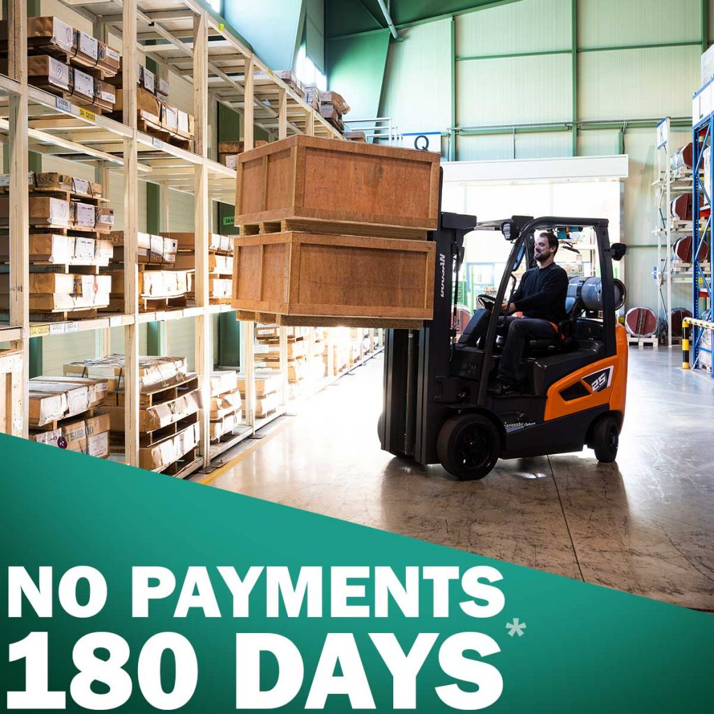180 days no payments ad doosan operator moving crates on forklift
