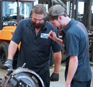 doosan techs inspecting a forklift